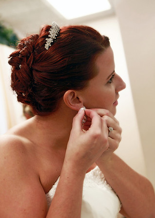 Detail photo of bride showing intricate updo hairstyle with rinestone pins and clip.