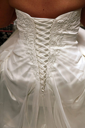 Photo of beutiful tie up wedding dress back with lace edging.